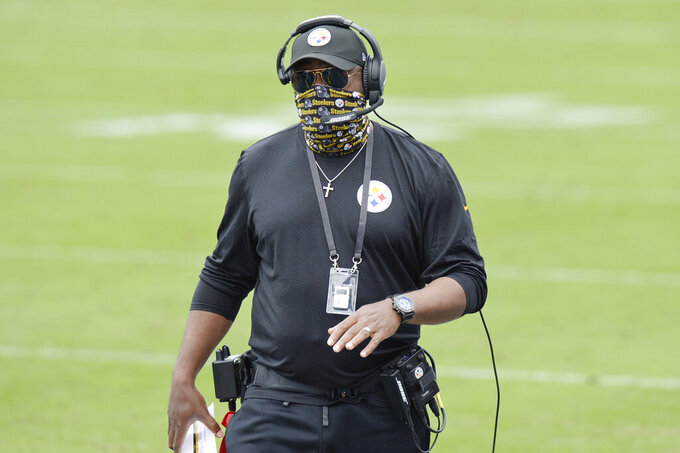 Pittsburgh Steelers head coach Mike Tomlin watches from the sideline in the first half of an NFL football game against the Tennessee Titans Sunday, Oct. 25, 2020, in Nashville, Tenn. (AP Photo/Mark Zaleski)