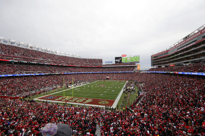 FILE - In this Jan. 19, 2020, file photo, fans at Levi's Stadium watch as the Green Bay Packers kickoff to the San Francisco 49ers during the first half of the NFL NFC Championship football game in Santa Clara, Calif. The San Francisco 49ers will play their season opener without fans in attendance because of the COVID-19 pandemic. The team said Tuesday, Aug. 25, 2020, after consulting with local officials that the Sept. 13 game against Arizona at Levi's Stadium will be played without spectators. The team said it would work with state and county officials to determine whether it will be safe to allow fans to attend games later this season. (AP Photo/Jeff Chiu, File)