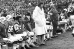 FILE - In this Nov. 14, 1971, file photo, New York Jets quarterback Joe Namath, wearing his white fur coat, watches from the sidelines as the Baltimore Colts defeat the Jets, 14-13, at New York's Shea Stadium. Namath is the NFL's greatest character. Guaranteed. The Pro Football Hall of Fame quarterback who guaranteed his three-touchdown underdog New York Jets would beat the mighty Baltimore Colts in the third Super Bowl was a solid choice in balloting conducted by The Associated Press in conjunction with the league's celebration of its 100th season.  (AP Photo/File)