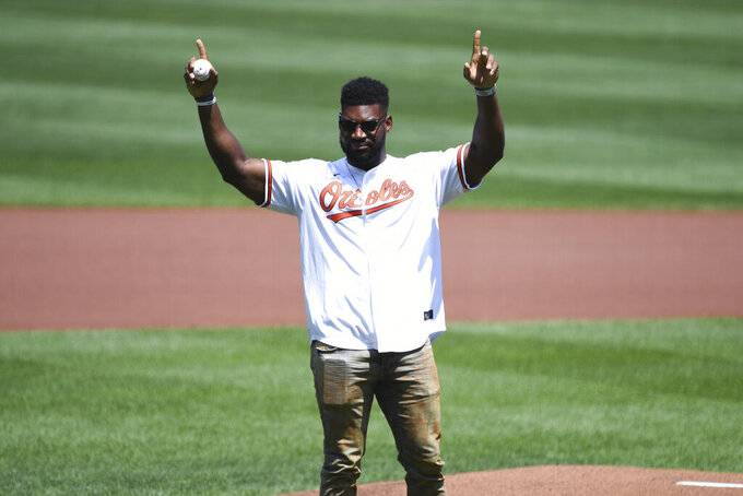 Baltimore Ravens' Tyus Bowser prepares to throw out the ceremonial first pitch before a baseball game between the Baltimore Orioles and the Tampa Bay Rays, Sunday, Aug. 8, 2021, in Baltimore. (AP Photo/Terrance Williams)