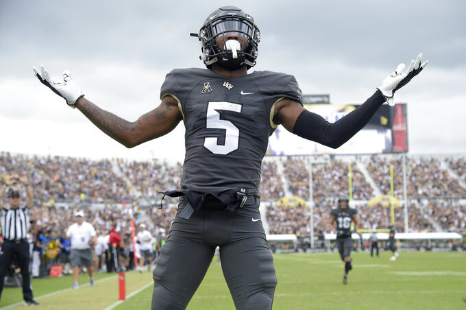 Central Florida wide receiver Dredrick Snelson (5) celebrates in the end zone after scoring a 34-yard receiving touchdown during the first half of an NCAA college football game against Navy, Saturday, Nov. 10, 2018, in Orlando, Fla. (AP Photo/Phelan M. Ebenhack)