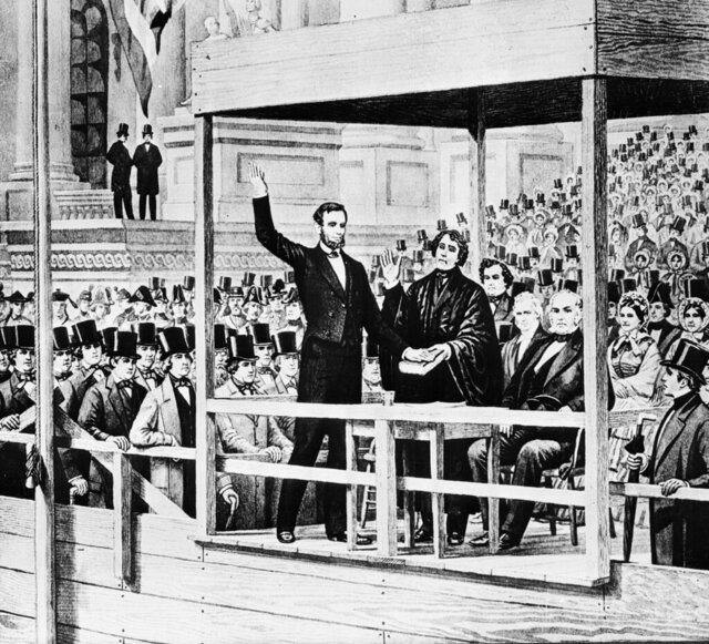 "FILE - This images shows a depiction of Abraham Lincoln taking the oath of office as the 16th president of the United States administered by Chief Justice Roger B. Taney in front of the U.S. Capitol in Washington, on March 4, 1861. Historians cite the first inaugural speeches of Thomas Jefferson and Abraham Lincoln as possible parallels for Joe Biden, who has said his goal is to ""restore the soul"" of the country even as millions baselessly insist incumbent Donald Trump was the winner. (AP Photo, File)"