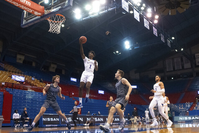 Kansas' Tyon Grant-Foster goes up for a layup against Washburn during an NCAA college basketball game Thursday, Dec. 3, 2020, in Lawrence, Kan. (Evert Nelson/The Topeka Capital-Journal via AP)