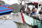 Fishermen fasten the boat as Typhoon Chanthu approaches to Taiwan in Keelung, New Taipei City, Taiwan, Saturday, Sept. 11, 2021. Taiwan's weather bureau warned of high winds and heavy rain as Typhoon Chanthu roared toward the island Saturday and said the storm's center was likely to pass its east coast instead of hitting land. (AP Photo/Chiang Ying-ying)
