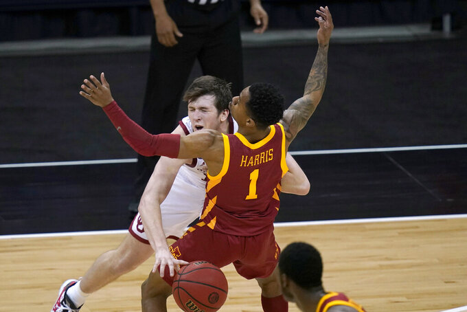 Oklahoma guard Austin Reaves, back, is fouled by Iowa State guard Tyler Harris (1) during the second half of an NCAA college basketball game in the first round of the Big 12 men's tournament in Kansas City, Mo., Wednesday, March 10, 2021. (AP Photo/Orlin Wagner)