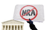 Protesters gather outside the Supreme Court in Washington, Monday, Dec. 2, 2019, during arguments in the first gun rights case before the Supreme Court in nine years. The case was filed by three New York City gun owners who are challenging a ban on carrying a licensed handgun outside city limits to a gun range, shooting competition or second home outside city limits. (AP Photo/Susan Walsh)