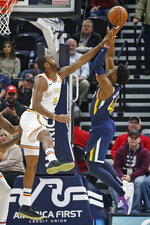 Golden State Warriors guard Alec Burks (8) defends against Utah Jazz guard Donovan Mitchell, right, in the first half during an NBA basketball game Friday, Dec. 13, 2019, in Salt Lake City. (AP Photo/Rick Bowmer)