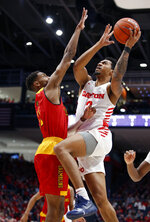 Dayton guard Ibi Watson (2) puts up a shot against Grambling State guard Kelton Edwards, left, during the first half of an NCAA college basketball game, Monday Dec. 23, 2019, in Dayton, Ohio. (AP Photo/Gary Landers)