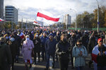 People with old Belarusian national flags march during an opposition rally to protest the official presidential election results in Minsk, Belarus, Sunday, Oct. 18, 2020. Tens of thousands rallied in Minsk once again on Sunday, demanding the resignation of the country's authoritarian leader. Mass weekend protests in the Belarusian capital have continued since Aug. 9, when officials handed President Alexander Lukashenko a landslide victory in an election widely seen as rigged. (AP Photo)