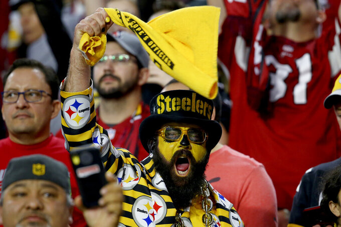 Pittsburgh Steelers fans cheer during the first half of an NFL football game against the Arizona Cardinals, Sunday, Dec. 8, 2019, in Glendale, Ariz. (AP Photo/Ross D. Franklin)