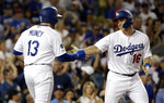 Los Angeles Dodgers' Will Smith (16) celebrates his two-run home run with Max Muncy (13) during the third inning of the team's baseball game against the Toronto Blue Jays on Tuesday, Aug. 20, 2019, in Los Angeles. (AP Photo/Marcio Jose Sanchez)