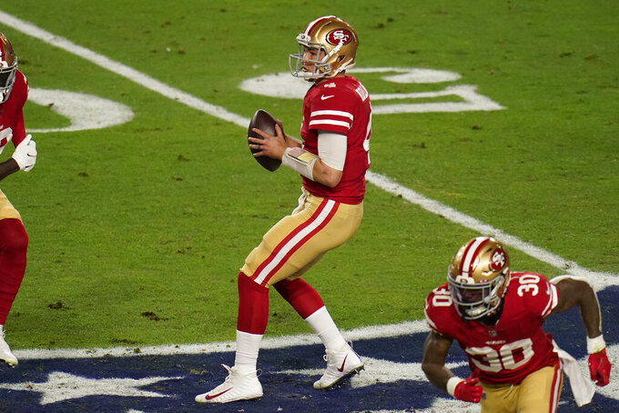 San Francisco 49ers quarterback Nick Mullens (4) looks to pass against the Buffalo Bills during the first half of an NFL football game, Monday, Dec. 7, 2020, in Glendale, Ariz. (AP Photo/Ross D. Franklin)