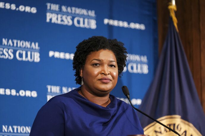 FILE - In this Nov. 15, 2019, file photo former Georgia House Democratic Leader Stacey Abrams, speaks at the National Press Club in Washington. Presumptive Democratic presidential nominee Joe Biden has already narrowed the field by saying he will pick a woman. In addition to Sen. Kamala Harris, Sen. Amy Klobuchar and Michigan Gov. Gretchen Whitmer, other names that have been part of the speculation are Sen. Elizabeth Warren of Massachusetts and Abrams. (AP Photo/Michael A. McCoy, File)