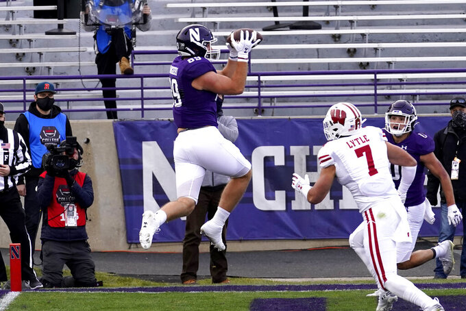 Northwestern tight end Charlie Mangieri, center, catches a touchdown pass during the first half of an NCAA college football game against Wisconsin in Evanston, Ill., Saturday, Nov. 21, 2020. (AP Photo/Nam Y. Huh)