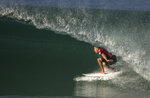 ILE - In this May 12, 2015, file photo, Kelly Slater competes in the Oi Rio Pro World Surf League event at Barra da Tijuca beach in Rio de Janeiro, Brazil. Professional surfers will be riding the waves again Sunday, Aug. 9, 2020, for the first time since the coronavirus pandemic shut down the sport in March. The Surf Ranch in Lemoore, Calif., some 100 miles from the Pacific Ocean, will provide a perfect bubble for the World Surf League's Rumble at the Ranch featuring 16 surfers, including 11-time world champion Slater and Olympic qualifiers Kolohe Andino, Caroline Marks and four-time reigning world champ Carissa Moore. (AP Photo/Leo Correa, File)