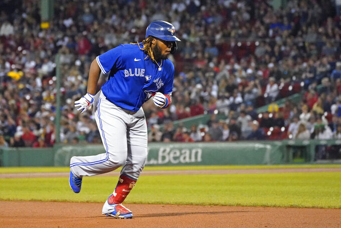 Toronto Blue Jays designated hitter Vladimir Guerrero Jr. runs the bases after hitting a two-run home run during the sixth inning of the team's baseball game against the Boston Red Sox at Fenway Park, Friday, June 11, 2021, in Boston. (AP Photo/Elise Amendola)