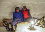 In this handout photo provided by British Antarctic Survey, field guide Sasha Doyle, left, and meteorological observer Jack Farr, right, sit in an igloo in Trident area, Adelaide island, in Antarctica in October 2019. Antarctica remains the only continent without COVID-19 and now in Sept. 2020, as nearly 1,000 scientists and others who wintered over on the ice are seeing the sun for the first time in months, a global effort wants to make sure incoming colleagues don't bring the virus with them. (Robert Taylor/British Antarctic Survey via AP)