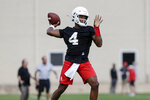 Houston quarterback D'Eriq King (4) looks to pass during NCAA college football practice in Houston, Texas, Saturday, Aug. 3, 2019. Houston plays at Oklahoma on Sunday, Sept. 1. (Tim Warner/Houston Chronicle via AP)