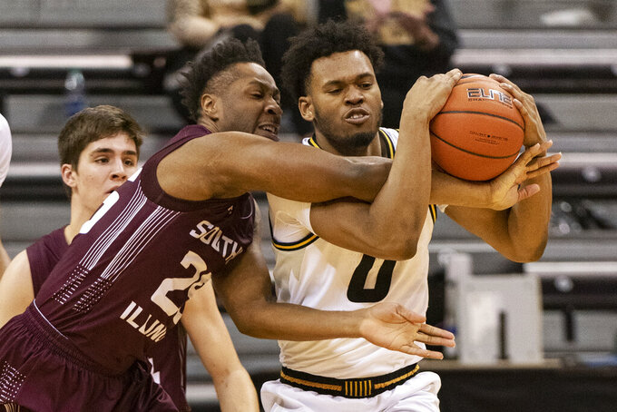 Missouri's Torrence Watson, right, and Southern Illinois' Brendon Gooch, left, battle for a rebound during the second half of an NCAA college basketball game Sunday, Dec. 15, 2019, in Columbia, Mo. (AP Photo/L.G. Patterson)