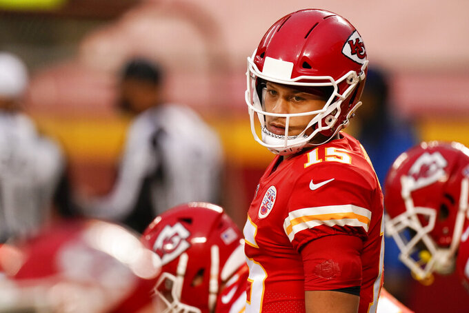 Kansas City Chiefs quarterback Patrick Mahomes (15) warms up before an NFL football game against the Houston Texans Thursday, Sept. 10, 2020, in Kansas City, Mo. (AP Photo/Charlie Riedel)
