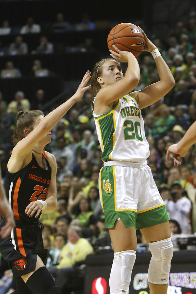 Oregon's Sabrina Ionescu, right, shoots ahead of Oregon State's Kat Tudor during the first quarter of an NCAA college basketball game in Eugene, Ore., Friday, Jan. 24, 2020. (AP Photo/Chris Pietsch)