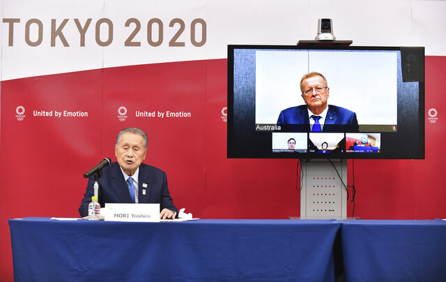FILE - In this April 16, 2020, file photo, Tokyo 2020 Organizing Committee President Yoshiro Mori, left, speaks in teleconference with John Coates, chairman of the IOC's Coordination Commission for the Tokyo 2020 Olympic Games, in Tokyo. The Tokyo Olympics were postponed a month ago. But there are still more questions than answers about the new opening on July 23, 2021 and what form those games will take.(Kazuhiro Nogi/Pool Photo via AP, File)