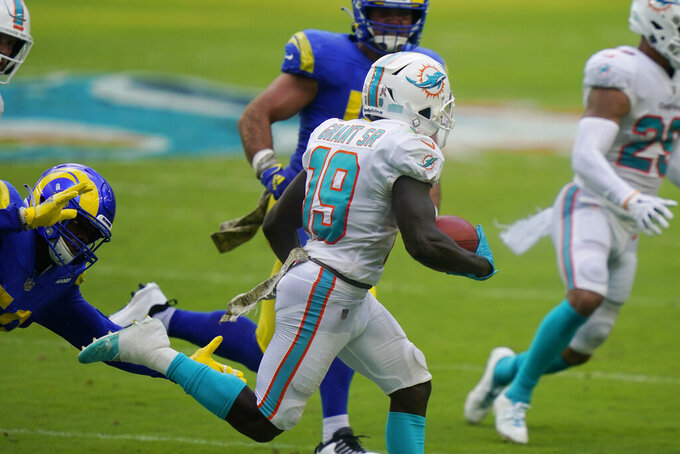 Miami Dolphins wide receiver Jakeem Grant (19) runs for a punt return touchdown during the first half of an NFL football game against the Los Angeles Rams, Sunday, Nov. 1, 2020, in Miami Gardens, Fla. (AP Photo/Lynne Sladky)