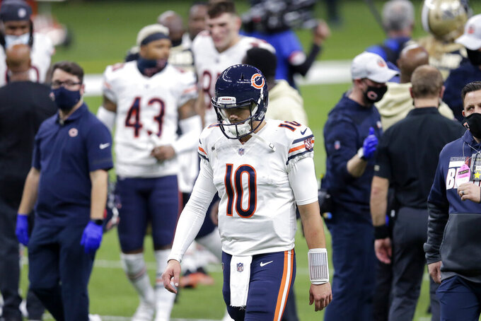Chicago Bears quarterback Mitchell Trubisky (10) walks off the field after an NFL wild-card playoff football game against the New Orleans Saints in New Orleans, Sunday, Jan. 10, 2021. The Saints now 21-9. (AP Photo/Brett Duke)