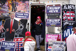 Trevor Horn, 12, checks out an RV full of President Donald Trump paraphernalia before the start of a rally in Wildwood, N.J., Tuesday, Jan. 28, 2020.  (AP Photo/Seth Wenig)