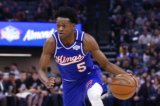 FILE - In this Feb. 20, 2020, file photo, Sacramento Kings guard De'Aaron Fox drives during the team's NBA basketball game against the Memphis Grizzlies in Sacramento, Calif. Fox agreed to a five-year, $163 million contract with the Kings on Friday, Nov. 20. (AP Photo/Rich Pedroncelli, File)