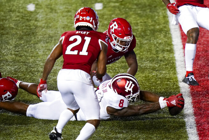 Indiana running back Stevie Scott III (8) is brought down near the goal line in the fourth quarter of an NCAA college football game against Rutgers, Saturday, Oct. 31, 2020, in Piscataway, N.J. (AP Photo/Corey Sipkin)