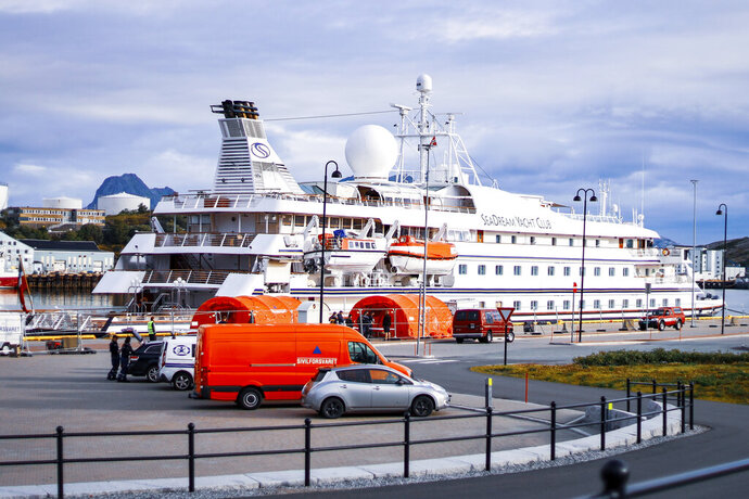 The cruise ship SeaDream 1 at the quay in Bodoe, Norway, Wednesday Aug. 5, 2020. The cruise ship with 123 passengers on board and a crew of 85 has docked in the Norwegian harbor of Bodoe but no one can disembark after a former passenger from Denmark tested positive for the coronavirus upon returning home. (Sondre Skjelvik/NTB Scanpix via AP)