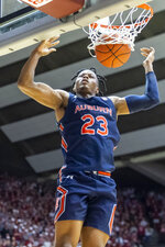 Auburn forward Isaac Okoro (23) slams two against Alabama during the first half of an NCAA college basketball game, Wednesday, Jan. 15, 2020, in Tuscaloosa, Ala. (AP Photo/Vasha Hunt)