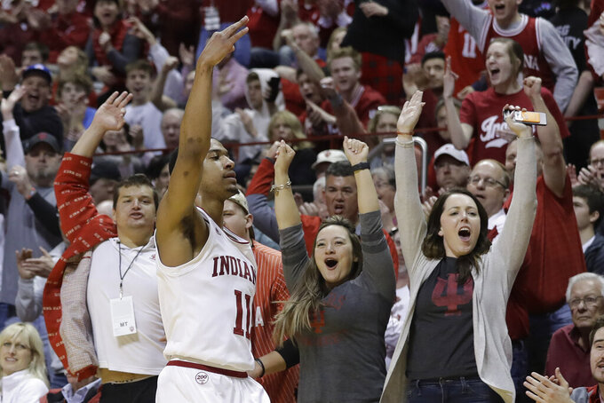 Indiana's Devonte Green (11) reacts after hitting a 3-point shot during the first half of the team's NCAA college basketball game against Minnesota, Wednesday, March 4, 2020, in Bloomington, Ind. (AP Photo/Darron Cummings)