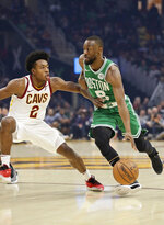 Boston Celtics' Kemba Walker (8) drives against Cleveland Cavaliers' Collin Sexton (2) in the first half of an NBA basketball game, Tuesday, Nov. 5, 2019, in Cleveland. (AP Photo/Tony Dejak)