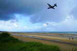 Three vintage World War II aircraft fly low over Omaha Beach in Colleville-sur-Mer, France, on Saturday, June 8, 2019. North Carolina veteran Ray Lambert returned to Normandy for the 75th anniversary of the D-Day invasion. (AP Photo/Allen G. Breed)