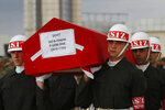 Turkish soldiers carry the Turkish flag-draped coffin of soldier Sefa Findik, killed in action in Syria earlier in the day, during a ceremony at the airport in Sanliurfa, southeastern Turkey, Sunday, Oct. 20, 2019.  This death brings Turkey's military death toll to seven soldiers in its wide-ranging offensive against Syrian Kurdish forces.(AP Photo/Lefteris Pitarakis)