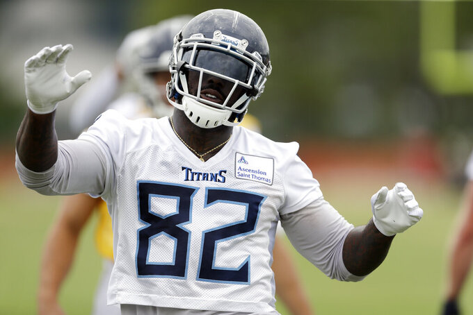FILE - In this May 30, 2019, file photo, Tennessee Titans tight end Delanie Walker warms up during an organized team activity at the Titans' NFL football training facility, in Nashville, Tenn. Walker is a week from his 35th birthday, and the Titans' three-time Pro Bowl tight end is heading into his 14th NFL season. He also believes he's in better shape than some 21-year-olds coming into the league. (AP Photo/Mark Humphrey, File)