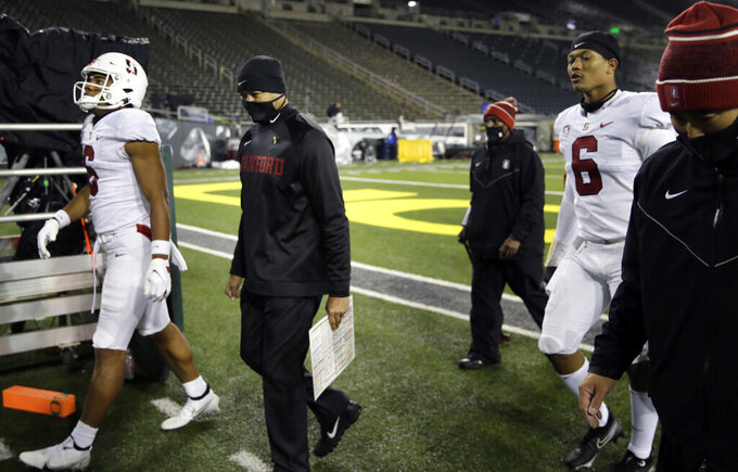 Stanford head coach David Shaw, second from left, leaves the field after being defeated by Oregon in an NCAA college football game Saturday, Nov. 7, 2020, in Eugene, Ore. (AP Photo/Chris Pietsch)