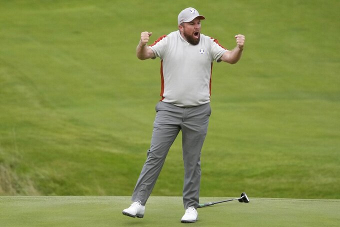 Team Europe's Shane Lowry celebrates on the 18th hole after makes a putt and winning their four-ball match the Ryder Cup at the Whistling Straits Golf Course Saturday, Sept. 25, 2021, in Sheboygan, Wis. (AP Photo/Charlie Neibergall)
