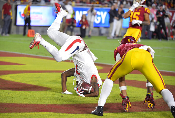Fresno State wide receiver Derrion Grim, left, tumbles in after catching a touchdown pass as Southern California cornerback Chase Williams defends during the first half of an NCAA college football game Saturday, Aug. 31, 2019, in Los Angeles. (AP Photo/Mark J. Terrill)