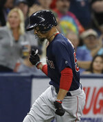 Boston Red Sox's Mookie Betts pumps his fist as he runs around the bases after hitting a home run off Tampa Bay Rays relief pitcher Diego Castillo during the eighth inning of a baseball game Friday, April 19, 2019, in St. Petersburg, Fla. (AP Photo/Chris O'Meara)