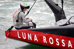 FILE - In this March 14, 2021, file photo, helmsman Jimmy Spithill sits on the gunwale as Italy's Luna Rossa is towed back to dock after race 7 against Team New Zealand was abandoned for the day in the America's Cup on Auckland's Waitemata Harbour, New Zealand. Three weeks after his Italian-based team lost the America's Cup match, Spithill is pivoting to SailGP and his role as CEO and helmsman of the reconfigured American team, which looks to bounce back from a last-place finish in the global league's inaugural season. (Alan Lee/Photosport via AP,File)