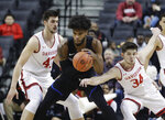 Saint Louis's Hasahn French, center, protects the ball from Davidson's Luke Frampton (34) and Dusan Kovacevic (43) during the first half of an NCAA college basketball game in the semifinal round of the Atlantic 10 men's tournament Saturday, March 16, 2019, in New York. (AP Photo)