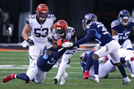 Cincinnati Bengals' Giovani Bernard (25) is tackled by Tennessee Titans' Jayon Brown (55) and Chris Jackson (35) during the first half of an NFL football game, Sunday, Nov. 1, 2020, in Cincinnati. (AP Photo/Bryan Woolston)