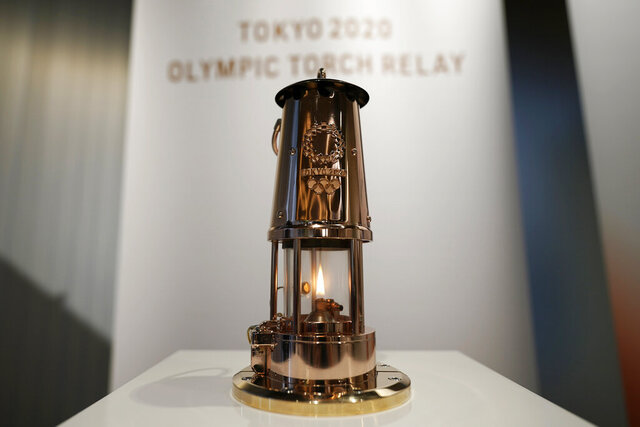 A lantern containing the Olympic Flame is shown prior to public display Monday, Aug. 31, 2020, in Tokyo. The Olympic flame is going on display in Tokyo, just a short walk from the new National Stadium where it was supposed to be burning a month ago.(AP Photo/Eugene Hoshiko)