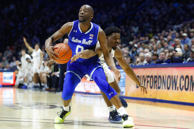 Seton Hall's Quincy McKnight, left, steals the ball from Xavier's Quentin Goodin, right, during the first half of an NCAA college basketball game, Wednesday, Jan. 8, 2020, in Cincinnati. (AP Photo/John Minchillo)