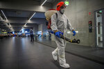Disinfection equipment is carried by a worker as precautionary measures against the spreading of novel coronavirus, at Budapest Liszt Ferenc International Airport in Budapest, Hungary, Wednesday, Feb. 5, 2020. So far almost 900 passenger arriving directly from China have been examined at the airport. (Zoltan Balogh/MTI via AP)