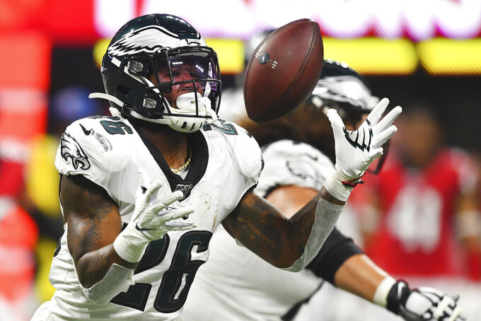 Philadelphia Eagles running back Miles Sanders (26) bobbles a pitched ball against the Atlanta Falcons during the first half of an NFL football game, Sunday, Sept. 15, 2019, in Atlanta. (AP Photo/John Amis)