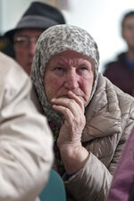 A relative of victims of the Srebrenica genocide awaits the decision of the UN appeals judges on former Bosnian Serb leader Radovan Karadzic in Potocari, Bosnia and Herzegovina, Wednesday, March 20, 2019. United Nations appeals judges on Wednesday upheld the convictions of Karadzic for genocide, war crimes and crimes against humanity, and increased his sentence from 40 years to life imprisonment. (AP Photo/Marko Drobnjakovic)
